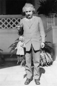 75Albert Einstein holding Einstein puppet1930